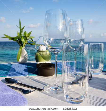 stock-photo-table-setting-at-beach-restaurant-12828712